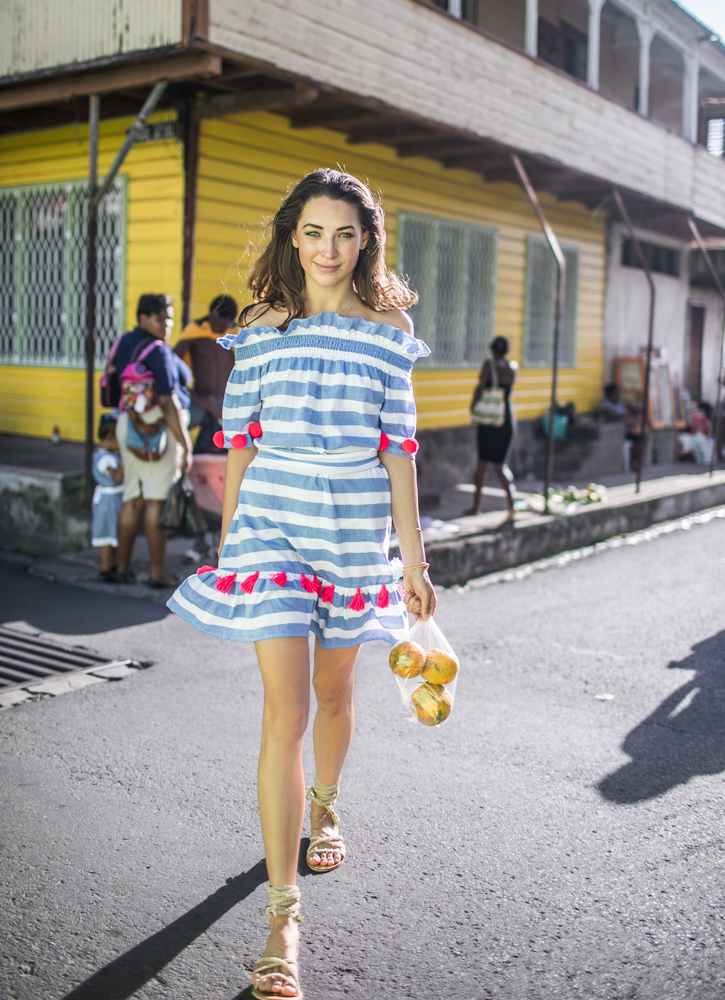Russian model and blogger Xenia and photographer Samuel Black exploring St Lucia. Xenia wears Sundress official in local fishermen villages.