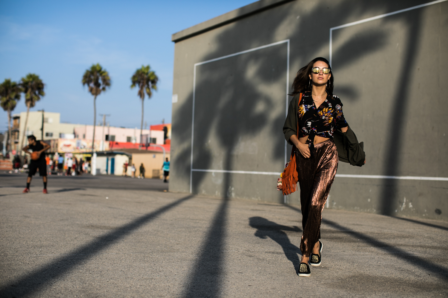 Fashion photographer Samuel Black shoots an editorial with model and streetstyle blogger Xenia Mz in Venice Beach, California